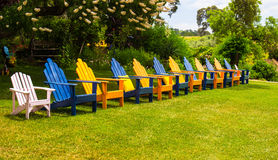 Row Of Lawn Chairs On Grass Stock Image