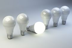 Row of LED light bulbs with one different from the others. Royalty Free Stock Photography