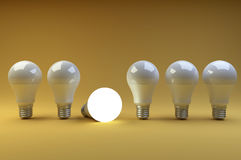 Row of LED light bulbs with one different from the others on a o Stock Image