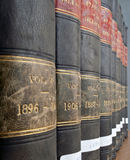 Row of Legal / Law books from 19th century. Vertical view of row of legal / law books from 19th century Royalty Free Stock Photos