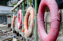 Row of Life Rings Hanging on Boat Railing Stock Photography