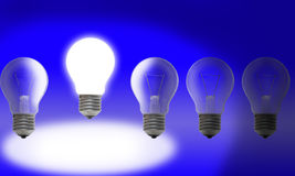 Row of light bulbs on blue background Royalty Free Stock Photography
