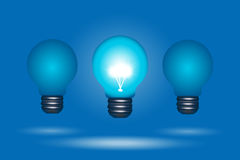 Row of light bulbs, one stands out Royalty Free Stock Image