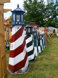 Row of lighthouses. Row of yard ornament lighthouses for sale Stock Photos