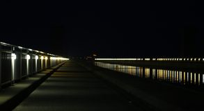 Row Of Lights On River Stock Image