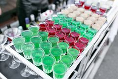Row line of different colored alcoholic cocktails on a party. wedding day or birthday.  Royalty Free Stock Photos