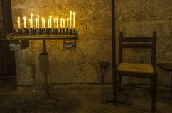 Row of lit candles inside a place of worship in Italy royalty free stock image
