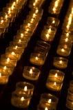 Row of lit tealights. A row of lit tealights Stock Photo