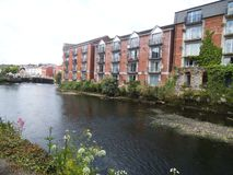 A row of living houses on a river in Cork. stock image