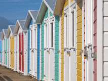 Row of locked English seaside chalets out of season Stock Photography