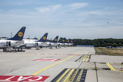 Row of Lufthansa flight with position at the apron. FRANKFURT, GERMANY - JULY 12, 2015: row of Lufthansa flight with position at the apron due to shortage of royalty free stock photos