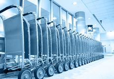 Row of luggage carts Stock Images