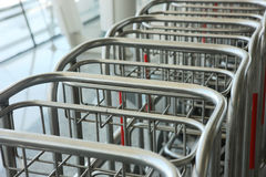 Row of luggage carts Stock Photos