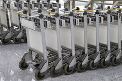Row of luggage carts in the airport Royalty Free Stock Photography