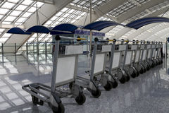 Row of luggage carts in the airport Stock Image