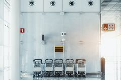 The row of luggage carts indoors royalty free stock images