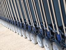 Row of luggage carts wheels Stock Images