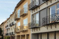 A row of luxury houses with balconies against blue Royalty Free Stock Image
