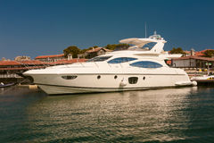 Row of luxury motorised yachts moored in a Royalty Free Stock Photos