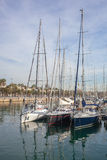 Row of luxury yachts mooring in a harbour Stock Image