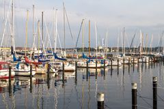 Luxury yachts in a harbour. Row of luxury yachts mooring in a harbour Stock Photography