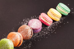 Row of macaroons on black Stock Images