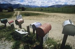 Row of mailboxes in non-urban setting stock image