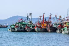 LRow of Malaysian fishing boats at the bay close to Kota Kinabalu. Row of Malaysian fishing boats at the bay close to Kota Kinabalu, Borneo, Malaysia royalty free stock images