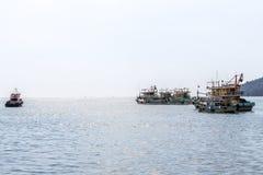 Row of Malaysian fishing boats at the bay close to Kota Kinabalu Stock Images