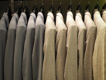 Row of male suit jackets in apparel store royalty free stock photos