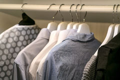 Row of the man and woman shirts on the hanger Stock Image