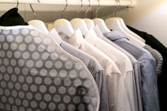Row of the man and woman shirts on the hanger Royalty Free Stock Photo