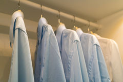Row of the man and woman shirts on the hanger Royalty Free Stock Photography