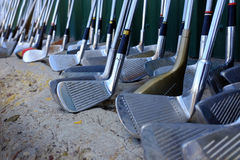 Row of Many Old Used Golf Clubs for Sport Royalty Free Stock Photography