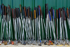 Row of Many Old Used Golf Clubs for Sport Stock Images