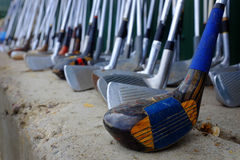Row of Many Old Used Golf Clubs for Sport Stock Image