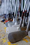 Row of Many Old Used Golf Clubs for Sport Royalty Free Stock Photos