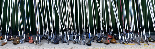 Row of Many Old Used Golf Clubs for Sport Royalty Free Stock Image