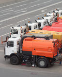 Row of many Watering cars on road. Row of many Watering machines on road Stock Photos