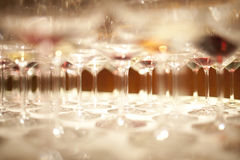Row of many white wine glasses Stock Photos