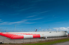 Row of massive windmill blades in storage Royalty Free Stock Photos