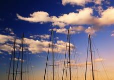 A row of masts at dawn Stock Photo