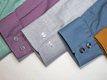Row of men's shirt sleeves Stock Image