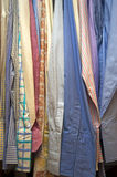 Row of men's shirts in closet Stock Image