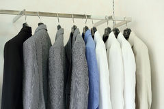 Row of men's suit jackets hanging in shop Stock Images