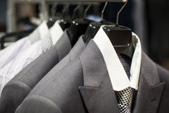 Row of men's suits hanging in closet. stock photography