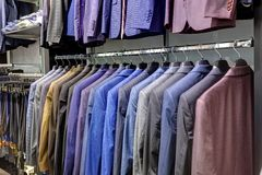 Row of men`s suits hanging in closet. stock photography
