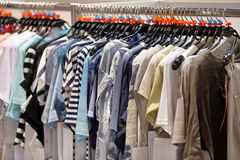 Row of men`s suits hanging on hanger Stock Image