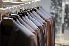 Row of men`s suits hanging on hanger.  Stock Images