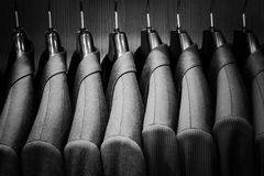 Row of men suit jackets. Black and white image Royalty Free Stock Photo